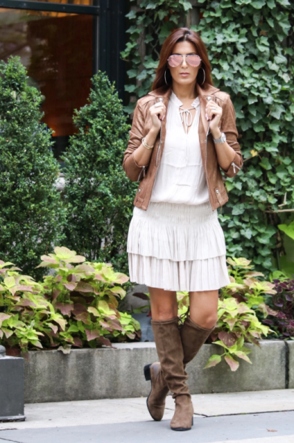 With white loose shirt, brown leather jacket and suede high boots