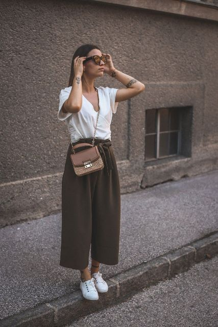 With white loose shirt, chain strap bag and white sneakers