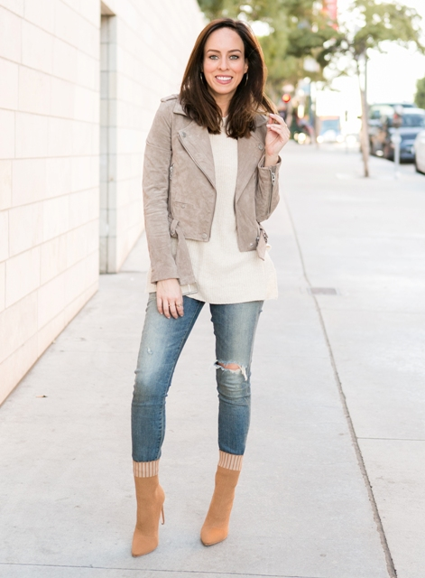 With white shirt, distressed jeans and gray suede crop jacket