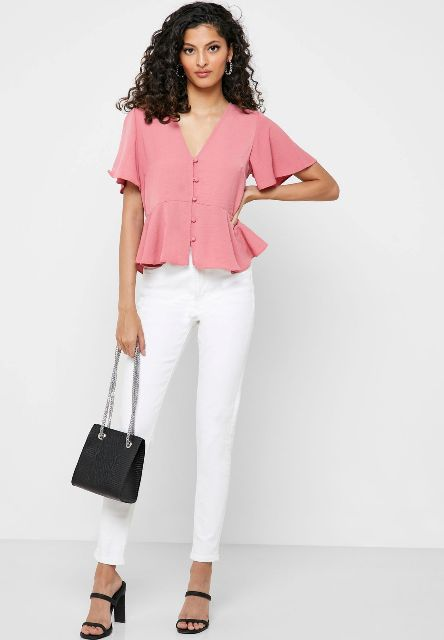 With white skinny pants, black chain strap bag and black high heels