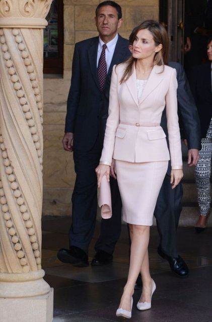 With white top, pale pink clutch and white pumps