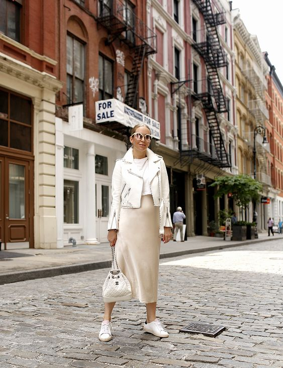 a beautiful spring look with a white t-shirt, a vanilla slip midi skirt, a white leather jacket, white sneakers and a bag