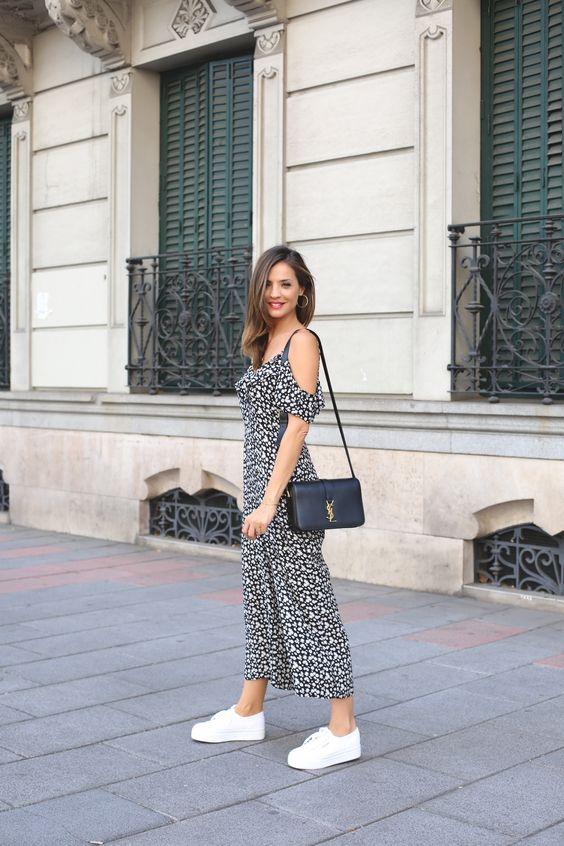 a black and white printed midi dress with a cold shoulder, white platform sneakers and a black bag for summer