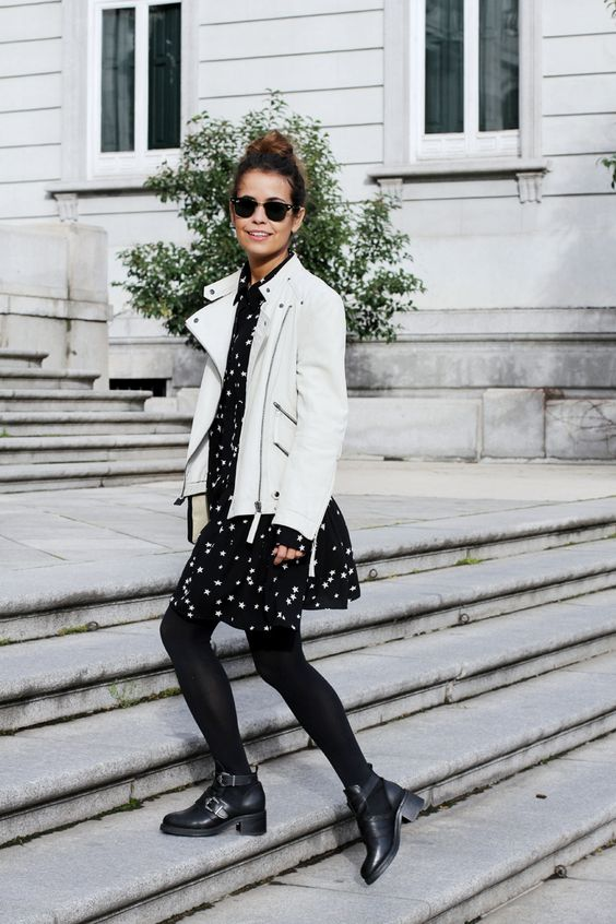 a black star print mini dress, black tights, cutout boots and a white leather jacket for a chic look