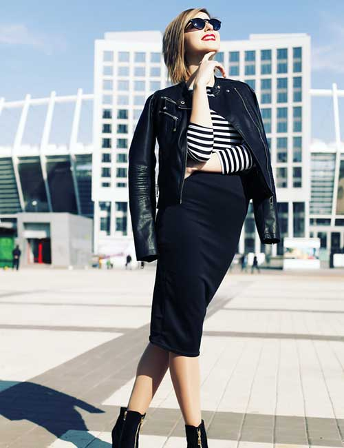 a chic look with a striped top, a black leather jacket, a black pencil midi, black boots