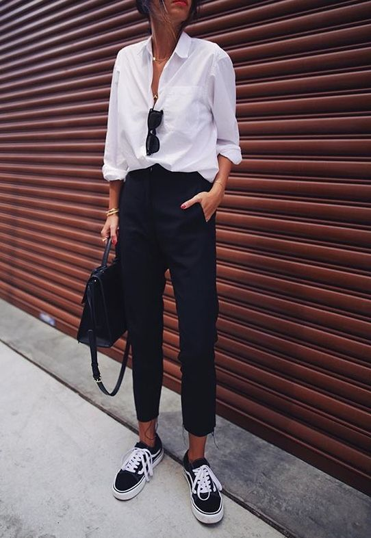 a comfy casual look with a white shirt, black pants, black sneakers and a black bag for every day