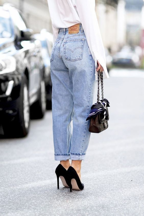 a cool look with a white shirt, light blue high rise boyfriends, black pumps and a black bag for spring