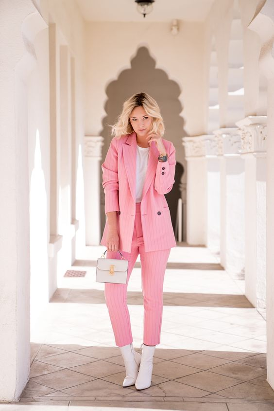 a cotton candy pink striped pantsuit, a white t-shirt, a mini bag and white booties