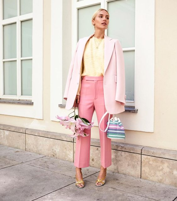 a creative work look with a yellow top, an oversized blush blazer, pink trousers, yellow shoes and a striped bag