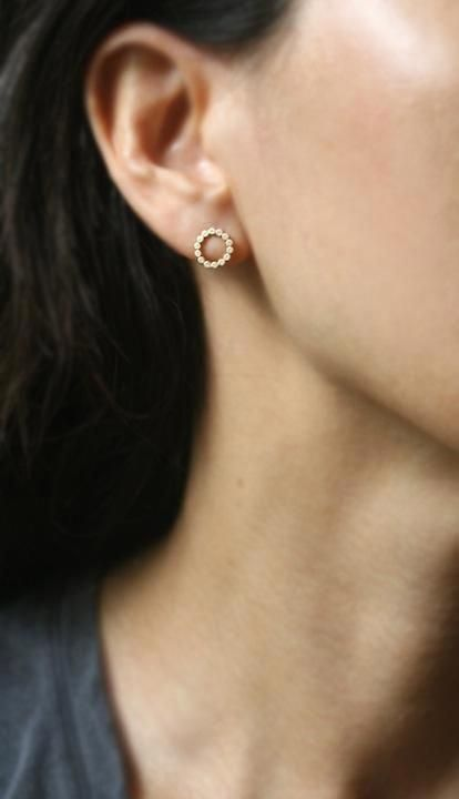 a flat circle stud earring without any crystals is a cool and fresh take on classics that will catch an eye