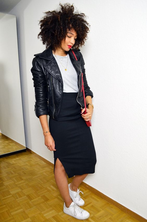 a grey t shirt, a navy pencil midi with a slit, a black leather jacket, a red bag and white sneakers