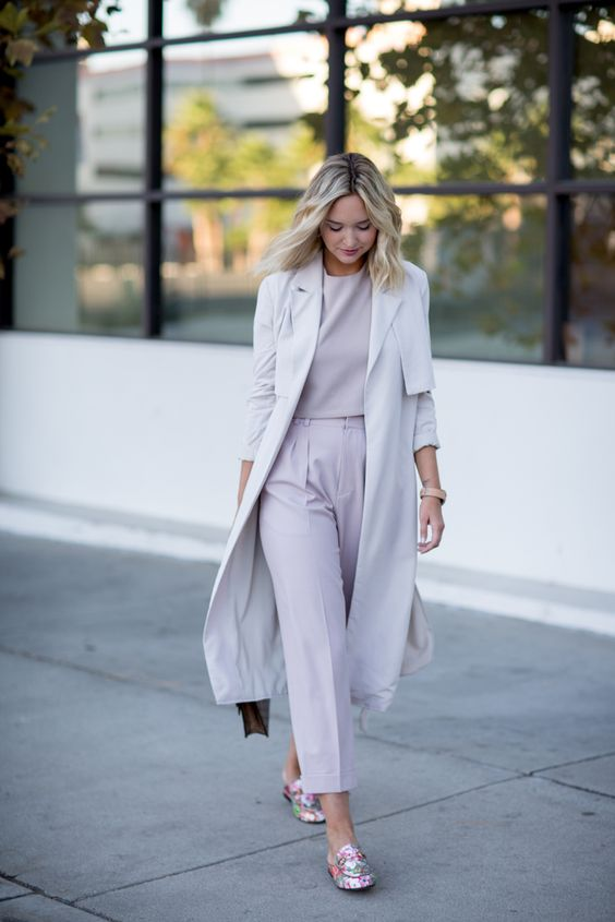 a lilac top, lilac cropped trousers, an off-white trench coat and floral mules that can be substituted with heels