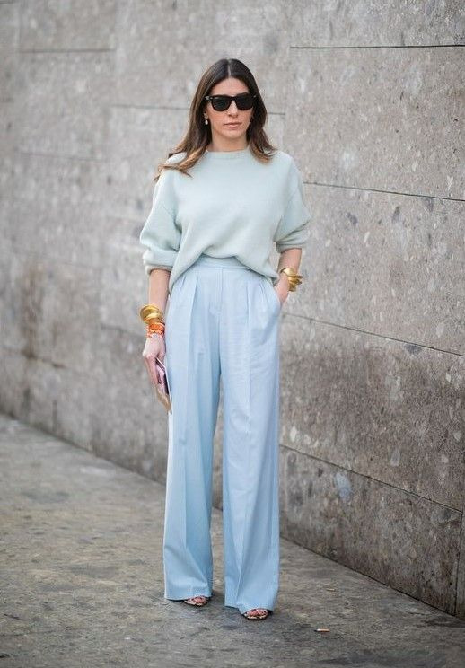 a pale blue oversized jumper, light blue trousers, statement bracelets and heels for spring