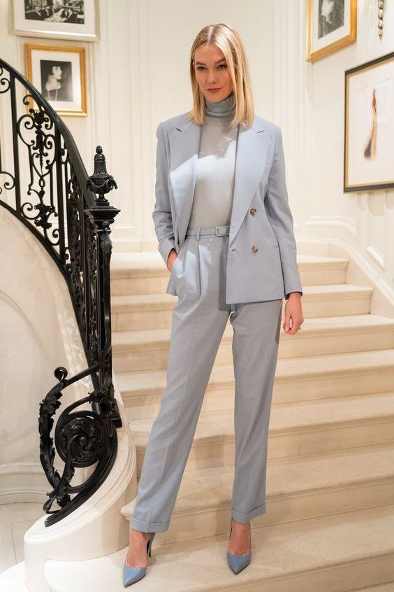 a pastel blue pantsuit, a grey turtleneck, blue heels for a super elegant and chic spring work look