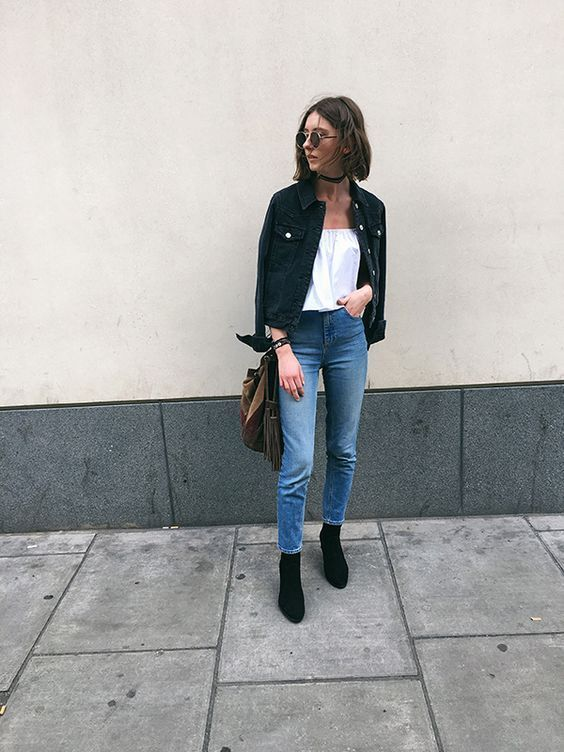 a pretty outfit with a white top, a black denim jacket, blue skinnies, black boots and a brown bag