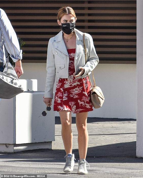 a red printed mini dress, white sneakers, a white leather jacket, a neutral bag