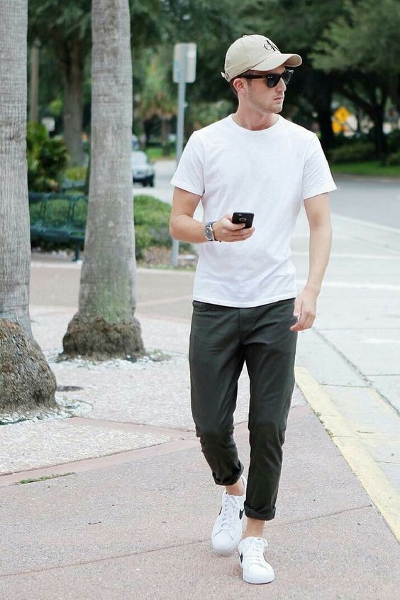 a simple casual look with a white tee, grey pants, white sneakers and a neutral baseball hat