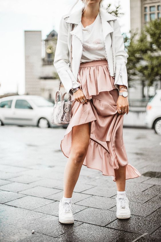 a spring look with a white tee, a rose tiered midi skirt, white sneakers and a white leather jacket