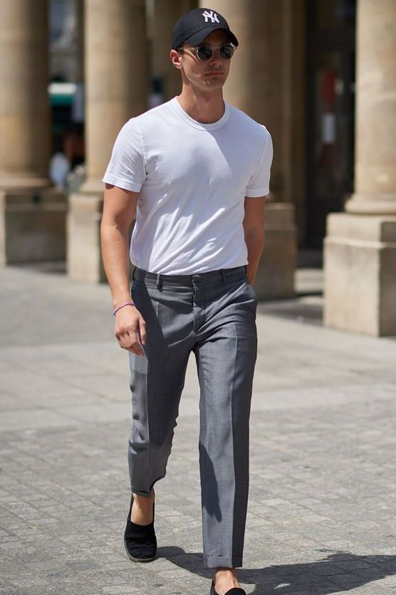 a stylish casual look with a white tee, grey pants, black espadrilles and a black baseball cap