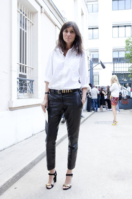 a stylish look with a white shirt, black leather pants, a pretty embellished belt and embellished shoes