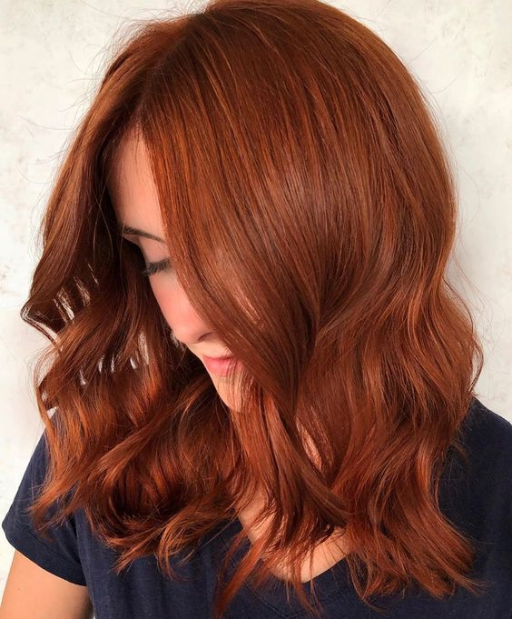 a wavy and textural ginger beer lob is a stylish choice if you want to make a statement with an elegant color