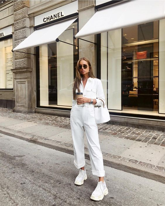 a white cargo jumpsuit, white dad trainers and a white bucket bag for a super elegant work look