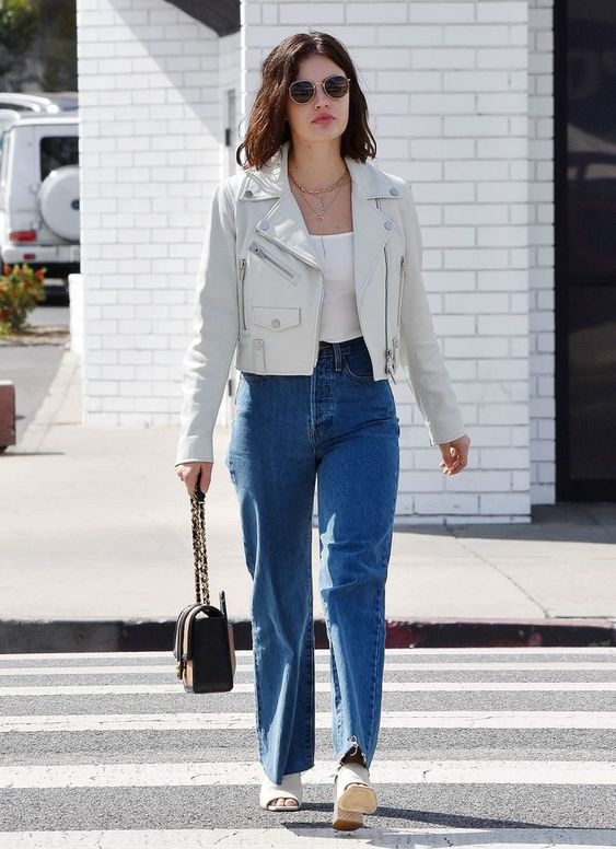 a white crop top, blue straight jeans, white mules and a white leather jacket for spring