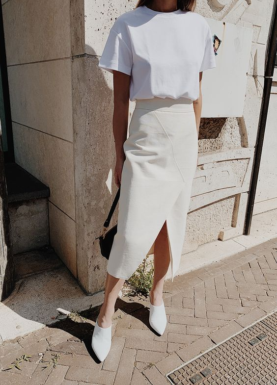 a white oversized tee, a creamy geometric pencil midi with a slit and white mules for summer