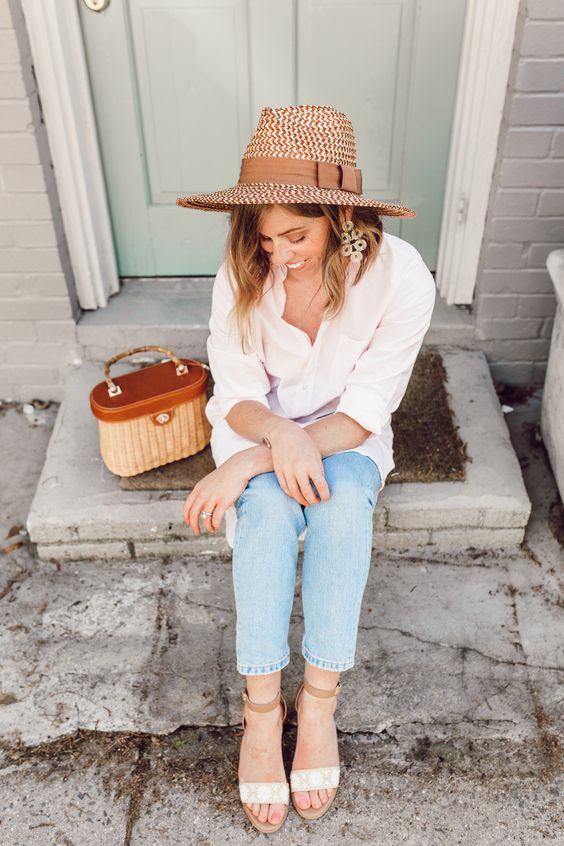 a white shirt, blue jeans, nude sandals, a hat and a pretty vintage bag for spring