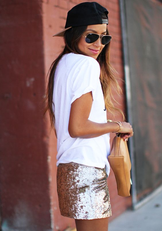 a white t-shirt, a orse gold sequin mini skirt, a black baseball cap and a tan clutch for summer