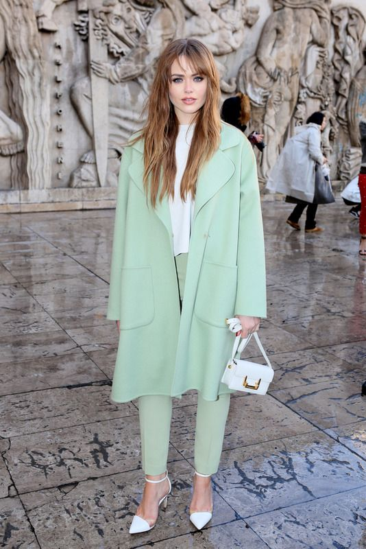 a white top, light green trousers, white heels and a mini bag plus a light green coat for a fresh spring look