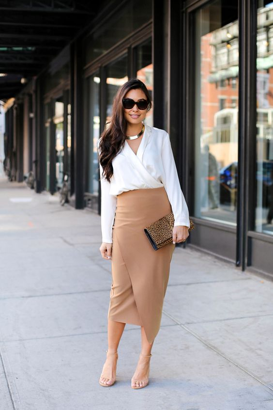 a work outfit with a white wrap blouse and a tan wrap epncil midi, tan heels and a statement necklace