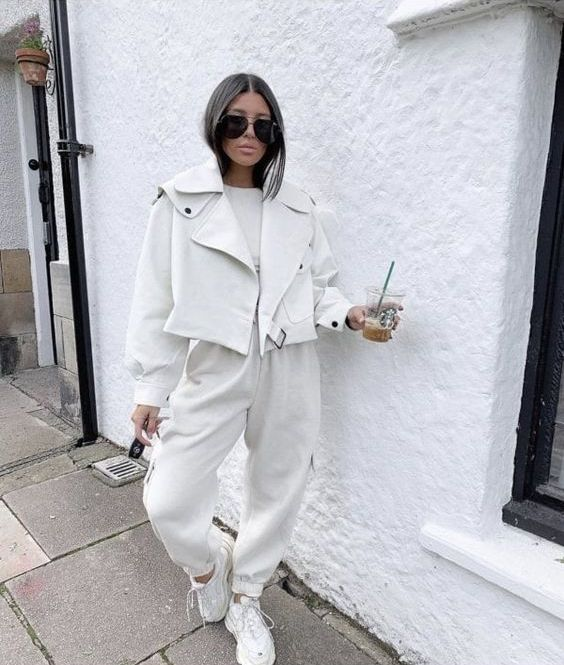an all white look with a tee, joggers, trainers, a leather jacket for spring is very comfy