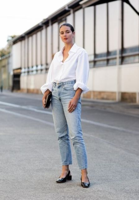 an oversized white shirt, blue boyfriends, black slingbacks and a black clutch for a simple and comfy work look