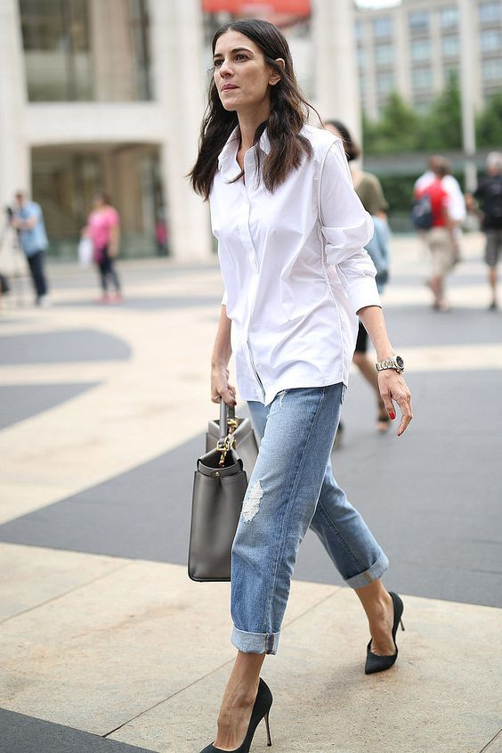 an oversized white shirt, blue ripped cropped boyfriends, black high heels, a grey tote for a casual work look