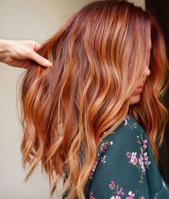 auburn hair with ginger balayage gives you a relaxed and sun-kissed look