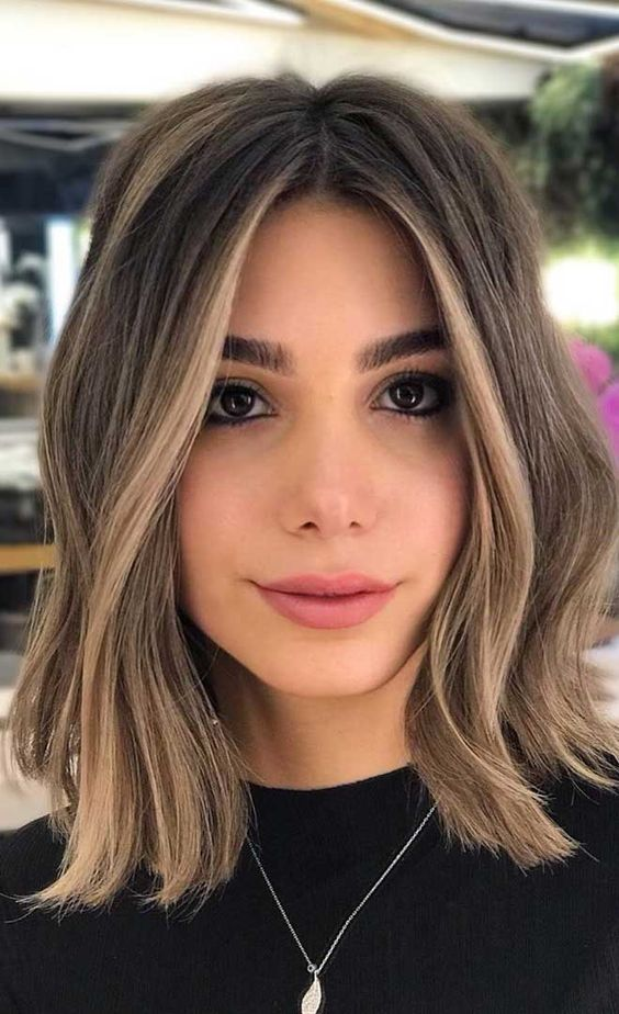 blonde balayage and face-framing highlights give more dimension and eye-catchiness to the long bob