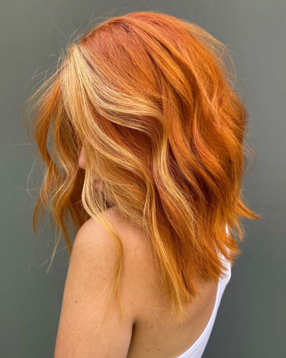 bold ginger hair with additional blonde face-framing highlights will make you stand out from any crowd