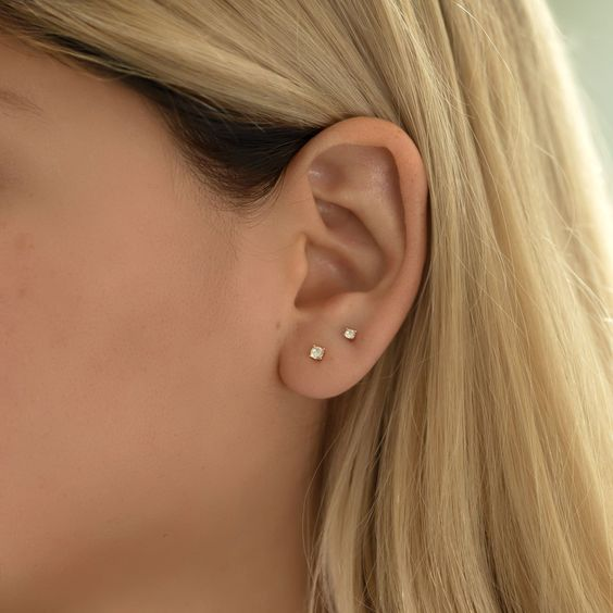 gold crystal studs, one smaller and another bigger, will always look good and very up to date