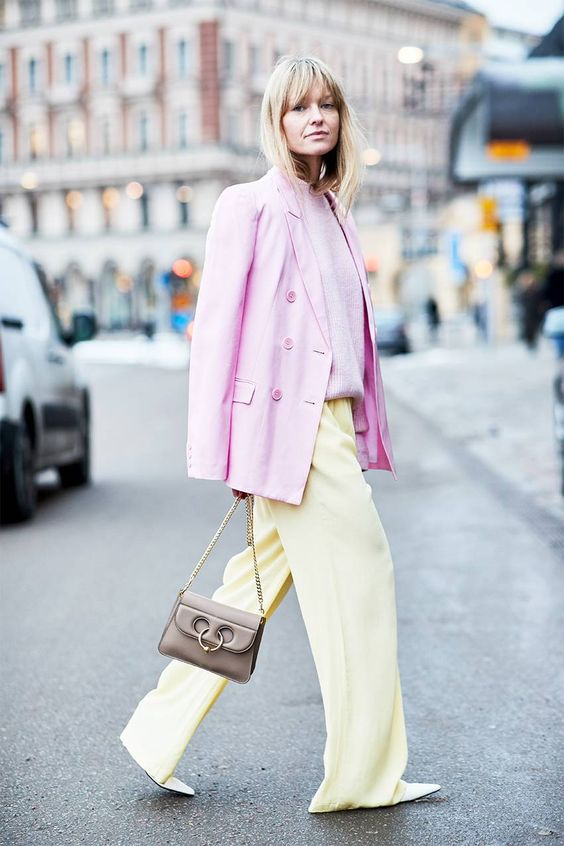 light yellow wideleg pants, a light pink jumper, a bright pink oversized blazer and a taupe bag for spring