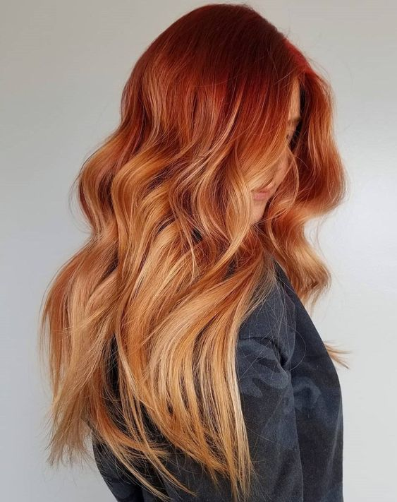 long wavy ombre hair going from auburn to ginger ont he ends is a gorgeous idea to make a statement