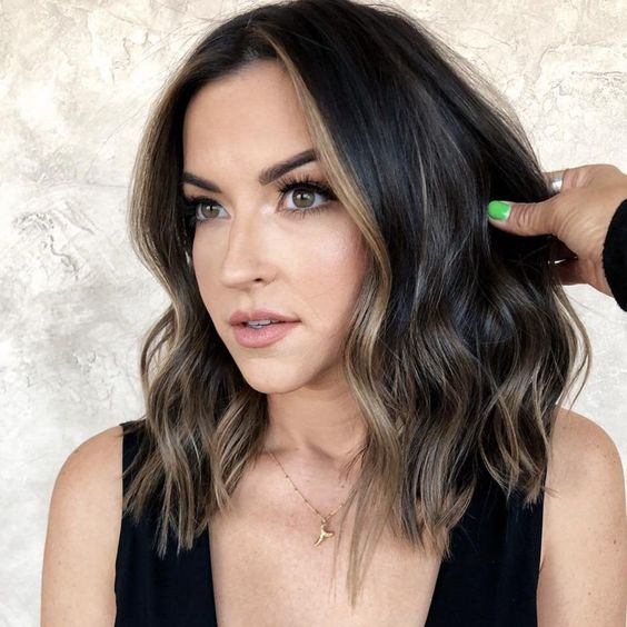 short black hair highlighted with ashy blonde balayage and face-framing highlights looks amazing