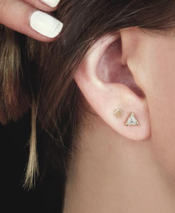 two modern gold studs – one with a crystal, another without, look very actual together