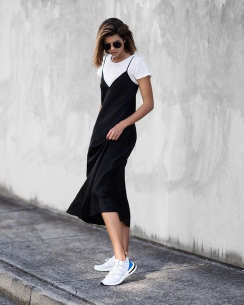 a contrasting look with a white t-shirt, a black slip midi dress, white trainers is a perfect solution
