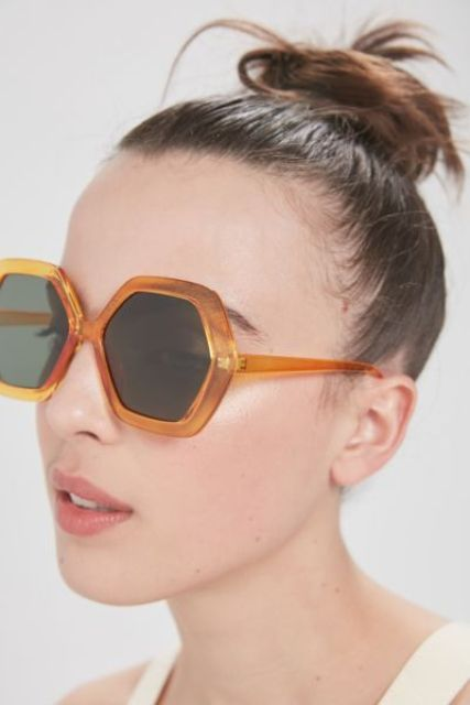08 bold orange hexagon sunglasses with dark glasses are a cool and fun accessory for sunny days