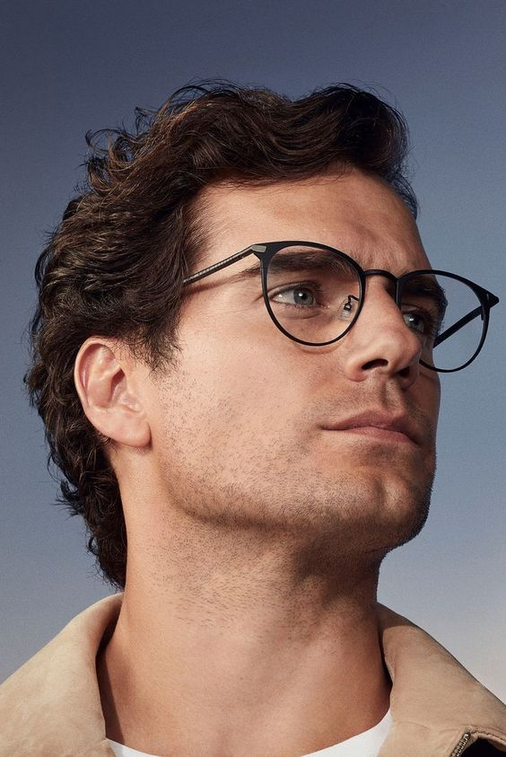 Henry Cavill wearing stylish black metal round glasses looks very Superman-like