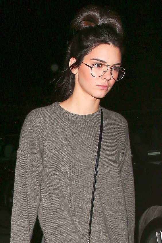 Kendall Jenner wearing flat top aviator glasses looks very trendy and very bold
