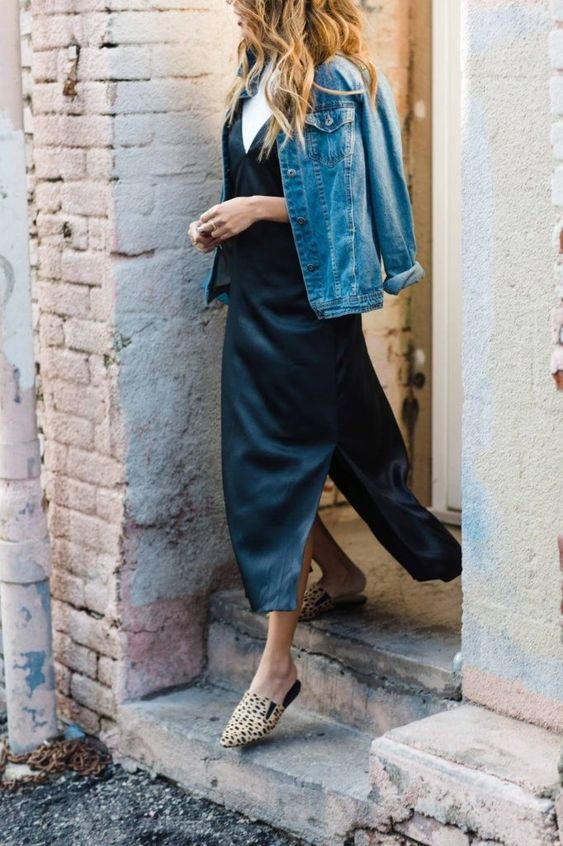 a white t-shirt, a black slip midi dress with side slits, a blue denim jacket and leopard print mules