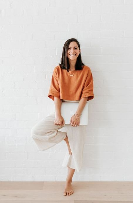 17 an orange linen crop top with short sleeves and neutral linen pants for both working and having calls