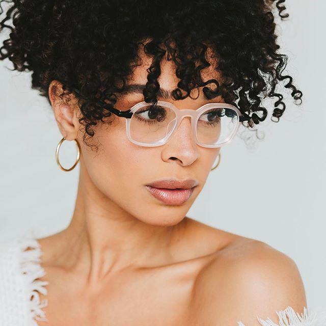 elegant pale pink and black round glasses will give you a touch of feminine chic